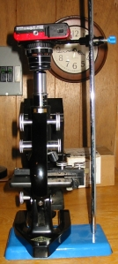 Vertical microscope with ring supported digital camera.