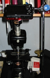 Fixed angle microscope with camera held at apropriate angle.