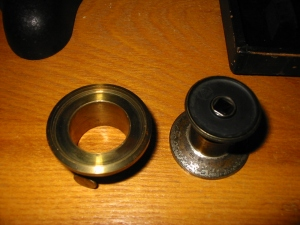 The left portion contains no optical components and is little more than a mounting collar.
