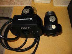 The AX-1 shutter beside a System II shutter