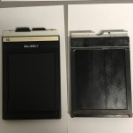 Two styles of 4x5 film holders one plastic one wood and metal